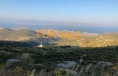 2013, 2 acres of land offering on the mountains of Legada/Lefkes - offering views of neighboring islands